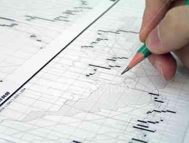 ist2_450124_stock_trader_at_work.jpg