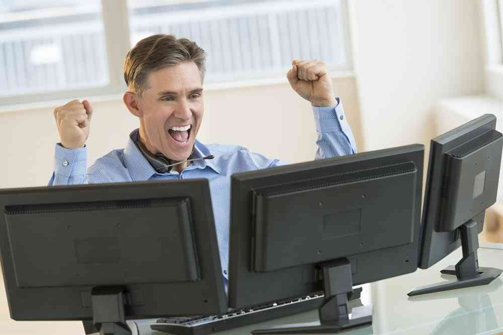 Successful Trader Screaming While Using Multiple Computers